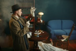 Male detective takes fingerprints from bottle